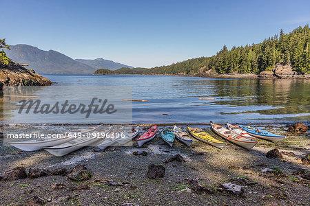 Sea kayaks moored on lakeside, Johnstone Strait, Telegraph Cove, Canada