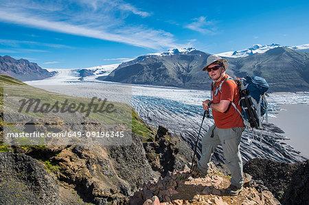 Man standing above Skaftafellsjokull glacier, Austur-Skaftafellssysla, Iceland