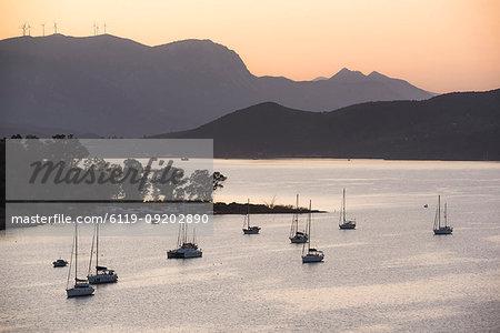 Sailing boats in Poros Island port at sunset, Saronic Island, Aegean Coast, Greek Islands, Greece, Europe