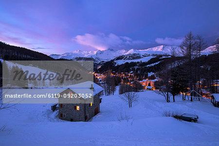 Stone chalet in snowy landscape at dawn, Madesimo, Spluga valley, Sondrio province, Valtellina, Lombardy, Italy, Europe