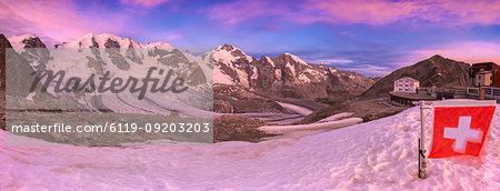 Sunrise at the Diavolezza Refuge with Swiss flag in foreground, Bernina Pass, Engadine, Graubunden, Switzerland, Europe