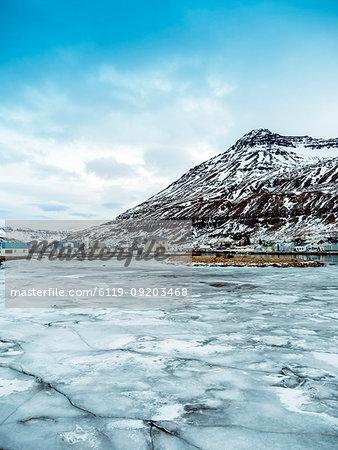 Seyoisfjorour city in winter before sunrise with ice frozen, Eastern region, Iceland, Polar Regions