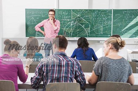 Teacher addressing students in class