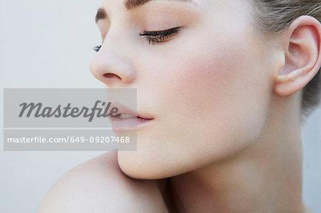 Studio head shot of serene young woman