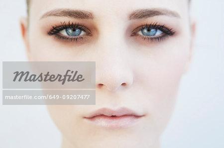Close up studio head shot of beautiful young woman