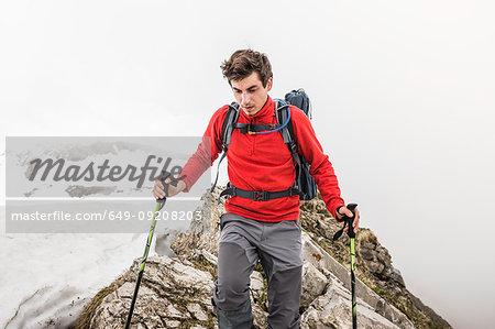 Young man trekking in Bavarian Alps, Oberstdorf, Bavaria, Germany