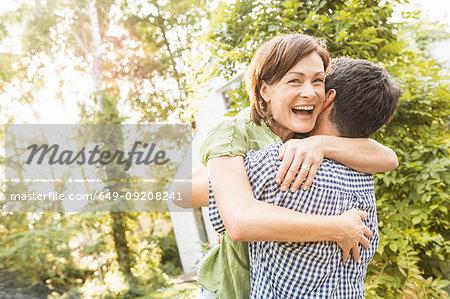 Couple hugging in garden