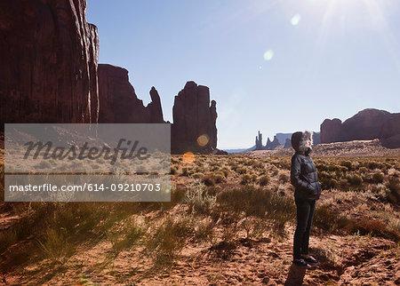 Female tourist alone in Monument Valley, Navajo Tribal Park, Arizona, USA