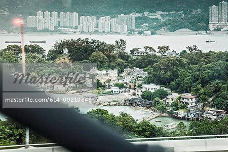 View of office blocks and harbor, Hong Kong, China