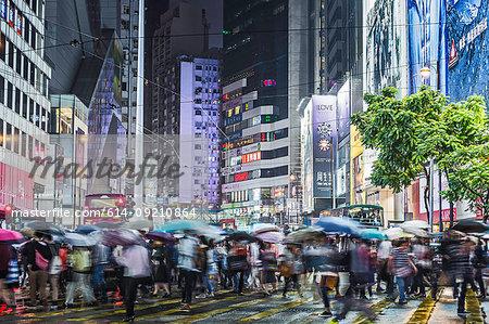 Crowded pedestrian crossing at night, Hong Kong, China