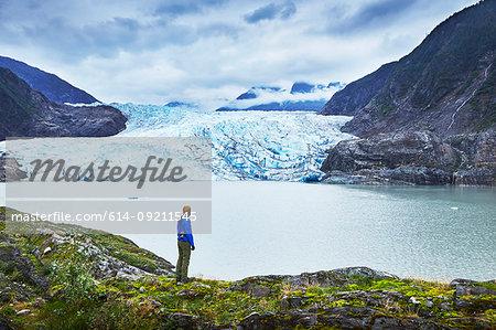 Male hiker gazing at Mendenhall Glacier, Juneau, Alaska, USA