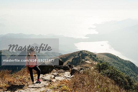 Young woman hiker on Lantau Peak looking away, Lantau Island, Hong Kong, China