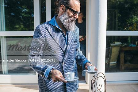 Man having coffee on patio