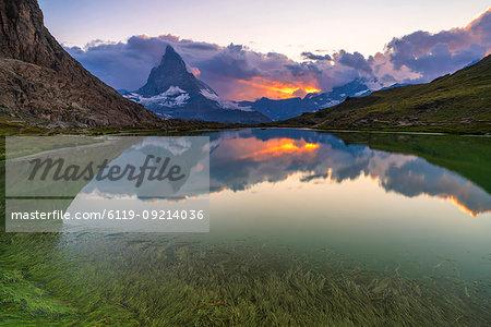 Sunset over the Matterhorn reflected in lake Riffelsee, Zermatt, canton of Valais, Swiss Alps, Switzerland, Europe