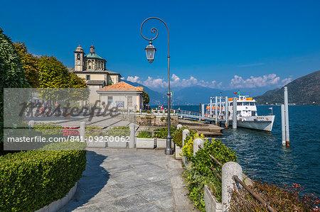 Cruiseboat moored near harbour and Santuario della SS Pieta Church in Cannobio, Lake Maggiore, Piedmont, Italian Lakes, Italy, Europe