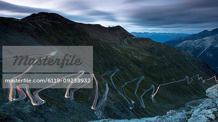 Light trails at night on The Stelvio Pass (Passo dello Stelvio), Eastern Alps, Italy, Europe