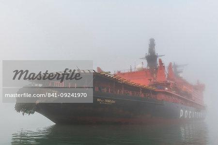 Icebreaker in the fog anchoring in Tikhaya bay on Hooker island, Franz Josef Land archipelago, Arkhangelsk Oblast, Arctic, Russia, Europe