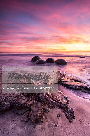 Moeraki Boulders with dramatic sunrise, Otago, South Island, New Zealand, Pacific