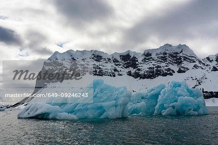 View of blue iceberg on coast, Burgerbukta, Spitsbergen, Svalbard, Norway