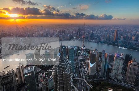 Pudong skyline and Huangpu river at sunset, high angle view, Shanghai, China