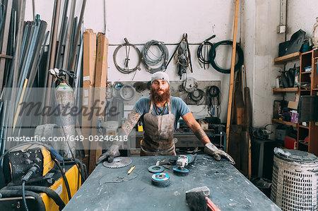 Axe maker in workshop