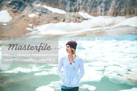 Woman enjoying view by lake, Jasper, Canada