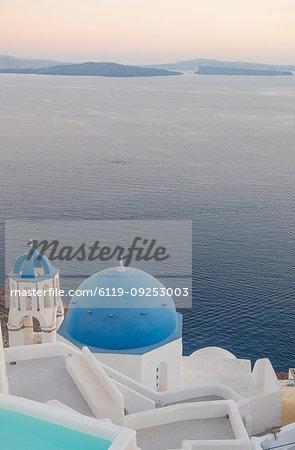 Oia at sunset in Santorini, Cyclades, Aegean Islands, Greek Islands, Greece, Europe