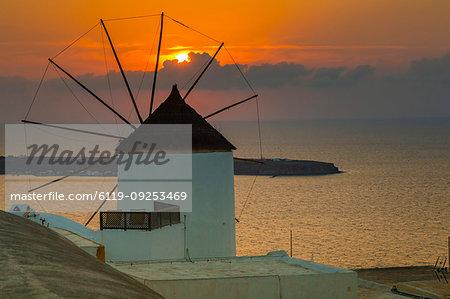 View of windmill at sunset in Oia village, Santorini, Cyclades, Aegean Islands, Greek Islands, Greece, Europe