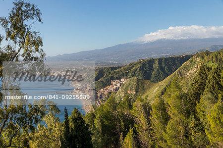 View from the public garden Parco Duca di Cesaro to Giardini Naxos and Mount Etna, Taormina, Sicily, Italy, Europe