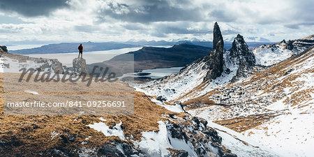 Hiker admiring view towards the Old Man of Storr, near Portree, Isle of Skye, Inner Hebrides, Highland, Scotland, United Kingdom, Europe