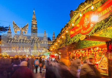 Rathaus and Christmas market stalls at night in Rathausplatz, Vienna, Austria, Europe