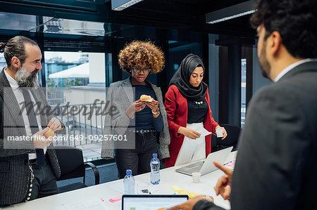 Business partners having tea break at meeting in office