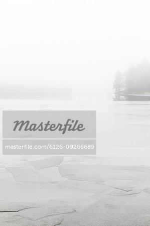 Fog on frozen Stora Skiren lake in Finspang, Sweden