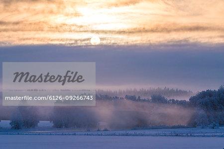 Sunbeam above foggy field