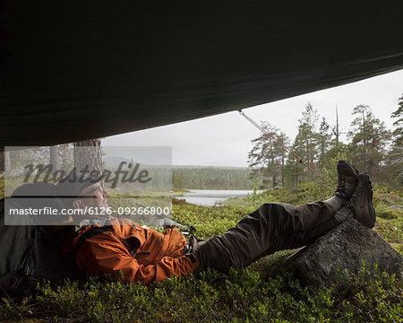 Man lying in tent