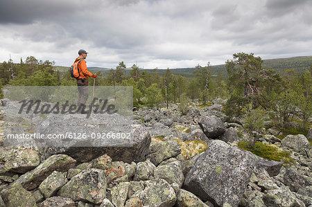 Hiker standing on rocks