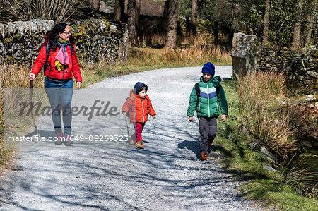 Mother and sons exploring national park, Llanaber, Gwynedd, United Kingdom