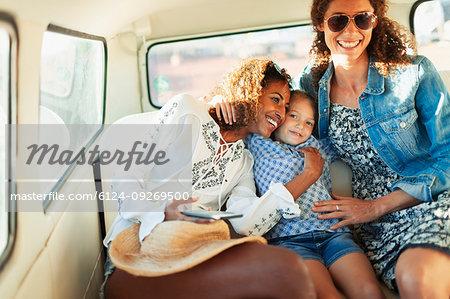 Happy women and girl riding in van