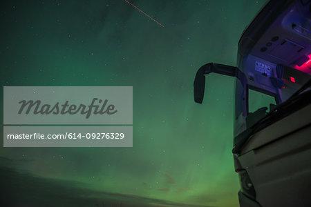 View of green aurora borealis sky at night, Vik, Iceland