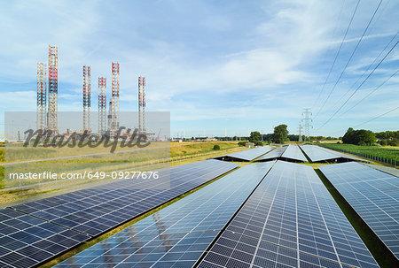 Large solar farms, disused oil rigs stored in Vlissingen harbour, Nieuwdorp, Zeeland, Netherlands
