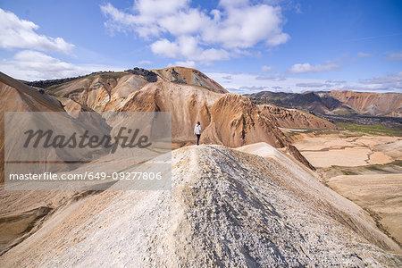 Hiker on peak, Brennisteinsalda and Bláhnjúkur, Landmannalaugar, Highlands, Iceland