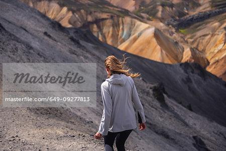 Hiker exploring mountains, Brennisteinsalda and Bláhnjúkur, Landmannalaugar, Highlands, Iceland