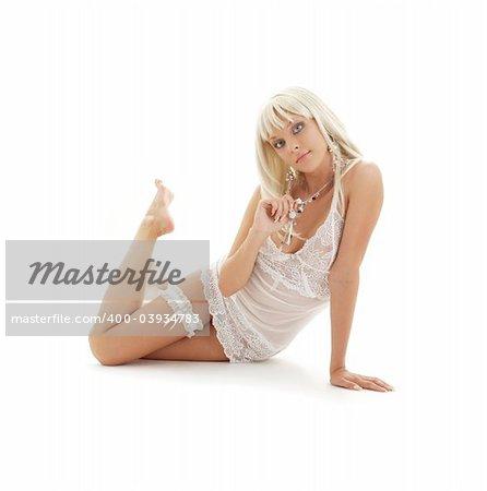 lovely blond in babydoll lingerie over white