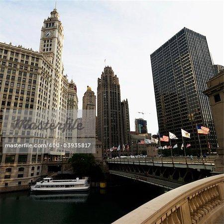 Chicago River scene with bridge and boat in Chicago, Illinois.