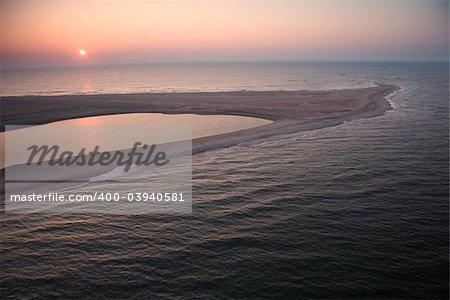 Scenic aerial view of sandbar at Baldhead Island, North Carolina at dusk.