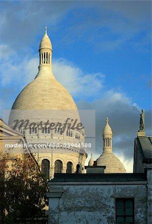 Sacre Coeur in Paris, France, as the sun begins to lower.