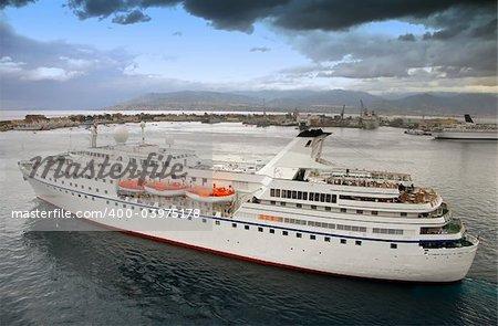 Mediterranean port in overcasr skys with ocean liner leaving