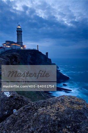 Mayor of Cape Lighthouse getting dark, Santander (Spain)