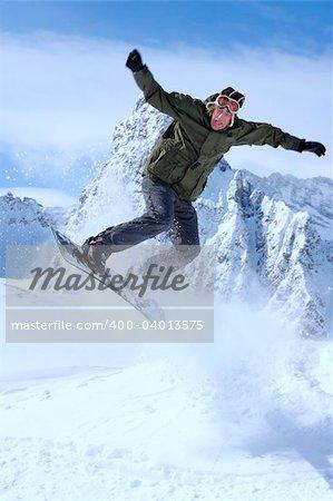 snowboarder taking jump in fresh fallen snow