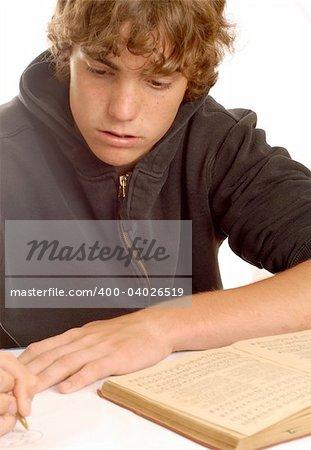 teenager doing homework isolated on white background
